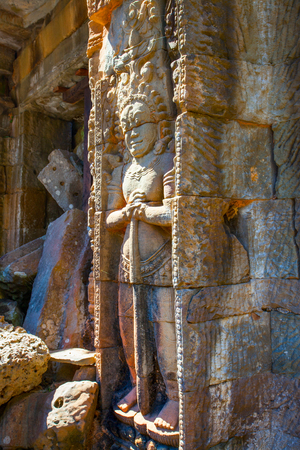 Guard - bas relief in Angkor Wat in Cambodia. Ancient khmer art