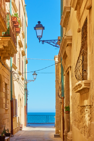 Old street by the sea in Syracuse, Sicily Island, Italy