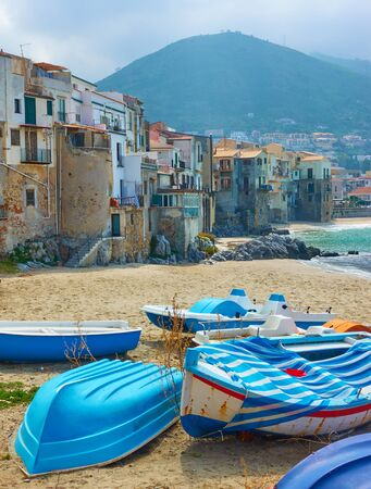 Boats on the sandy beach in the old town of Cefalu in Sicily, Italy 写真素材