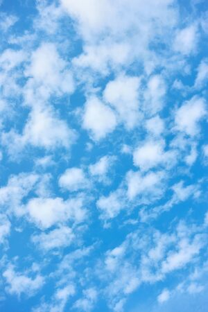 Blue spring sky with white clouds - natural textured background