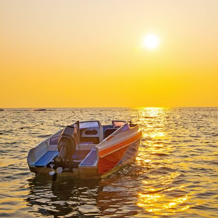 Sea and boat at sunset - Seascape