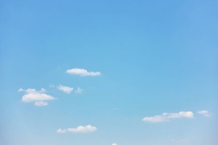 Light blue sky with white clouds - pastel color background with space for your own text