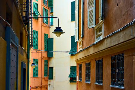 Genoese narrow street with old street light, Genoa, Italy Archivio Fotografico