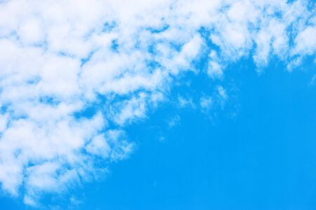 Partly cloudy - Blue sky with white clouds. Background with space for your own text