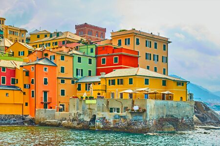 Colorful houses by the sea in Boccadasse district in Genoa, Ligurian shore, Italy