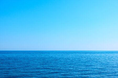 Seascape with sea horizon and clear blue sky - Background with large space for your own text