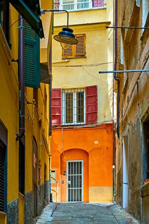 Old genoese street on summer sunny day, Genoa, Italy