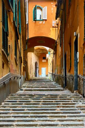 Picturesque genoese old uphill street with stairs, Genoa (Genova), Italy