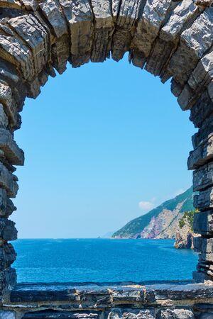 The sea through the ancient window near Church of St. Peter in Porto Venere (Portovenere) on Ligurian coast, La Spezia, Italy Landscape, seascape Reklamní fotografie - 129636736