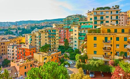 Picturesque residential buildings of Castelletto district in Genoa in the evening, Genova, Italy Reklamní fotografie - 129636853