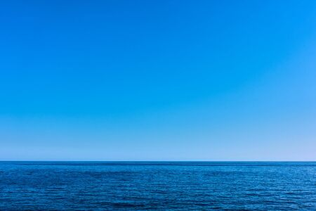 Seascape with sea horizon and clear blue sky - Background with space for your own text Reklamní fotografie - 129636356