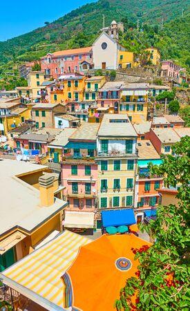 Vertical wide angle shot of beautiful Vernazza small town in Cinque Terre, La Spezia, Italy
