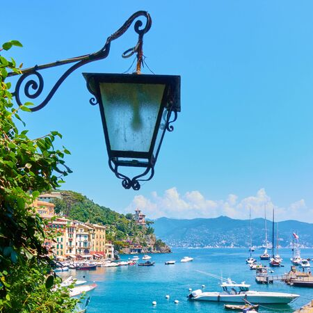 Vintage street light and harbour with yachts and boats in Portofino, Italy Reklamní fotografie - 129635837