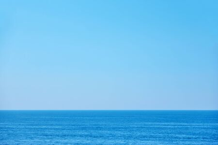 Sea horizon and clear light blue sky - Simple background with large space for your own text