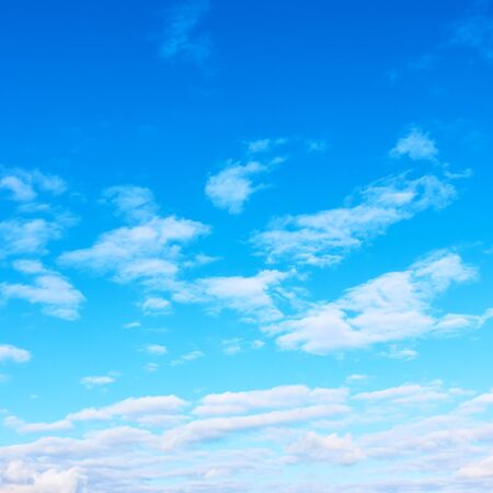 Blue sky with light white clouds -  background with copy space, square cropping Reklamní fotografie - 129635943
