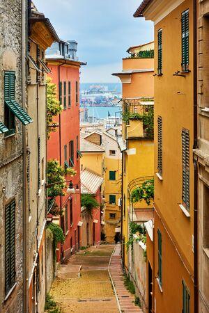 Old narrow street in Genoa city, Italy Reklamní fotografie - 129635949