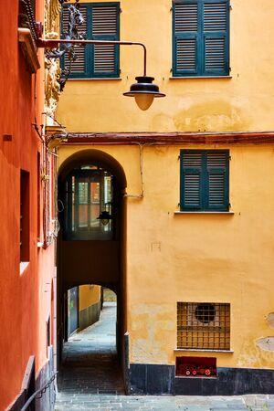 Old narrow street in Genoa city, Italy