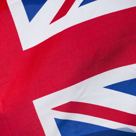 Union Jack - Flag of the United Kingdom waving in the wind closeup (detail) Reklamní fotografie