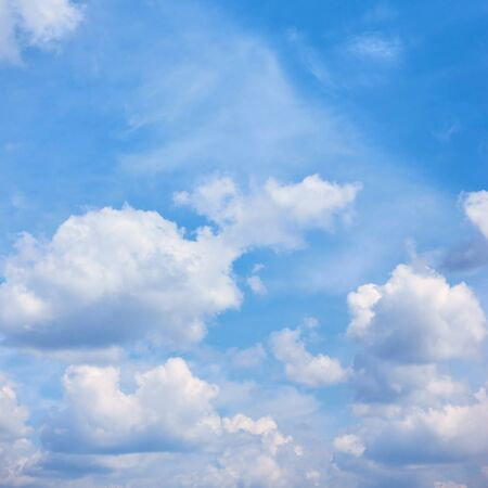 Blue sky with white heap clouds -  natural background, square cropping Reklamní fotografie - 129635272