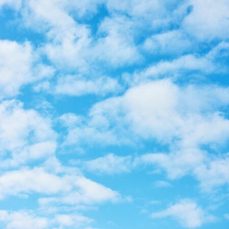 Blue sky with light white clouds -  natural textured background, square cropping
