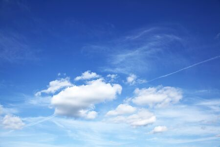 Deep blue sky with white heap clouds, may be used as background