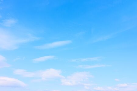 Light blue sky with clouds -  may be used as background