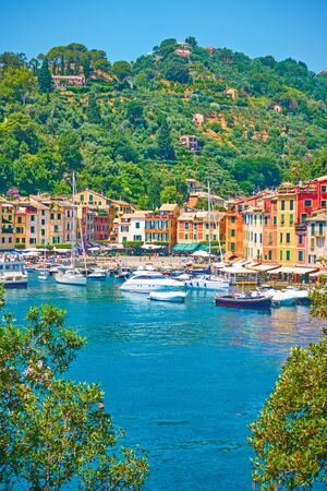 Port with boats and waterfront with colorful houses in Portofino town, Liguria, Italy Reklamní fotografie - 129634774