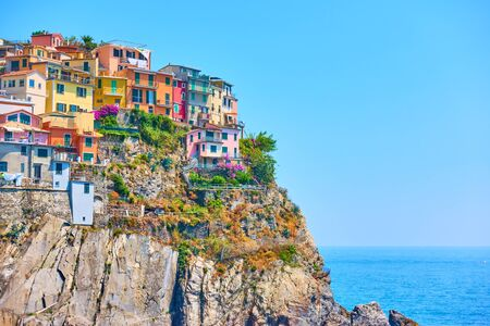 Small italian town with colorful buildings on the rock by the sea, Manarola, Cinque Terre, Italy. Copyspace composition Reklamní fotografie