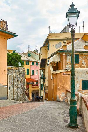 Old street with vintage street light in Boccadasse in Genoa (Genova),  Italy Stock Photo