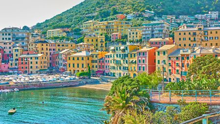 Coastal italian town - Waterfront with buildings by the sea in Genoa Nervi in the summer evening