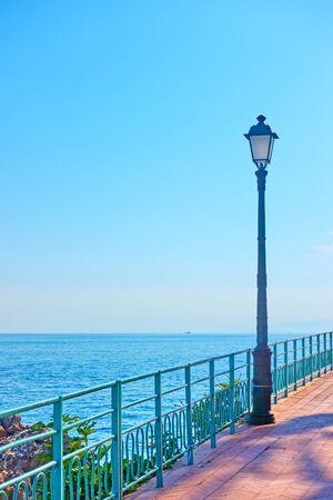 Promenade by the sea with retro street lights in Genova Nervi, Genoa, Italy Stock Photo