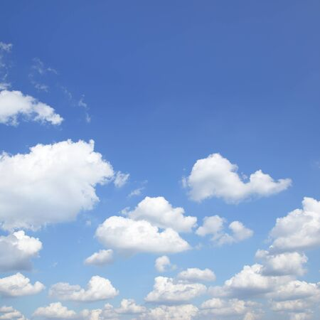 Blue summer sky with white heap clouds -  natural background, square cropping