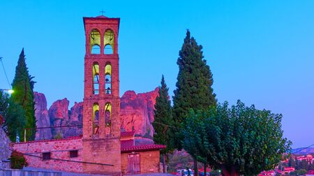 Bell tower of Holy Temple of Dormition of the Virgin Mary in Kalabaka town at twilight,  Thessaly, Greece - Landscape Reklamní fotografie