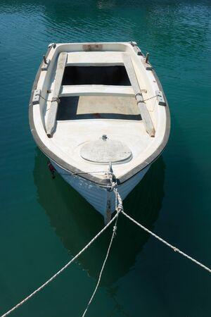 Small oar boat on the berth