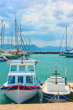 Port of Aegina and two small fishing boats, Saronic Islands, Greece