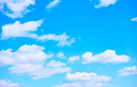 Blue sky with white heap clouds -  background with space for your own text