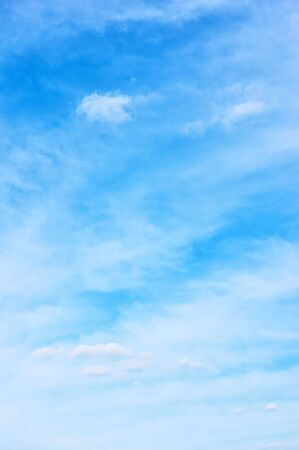 Blue sky with light clouds - vertical background and space ror your own text