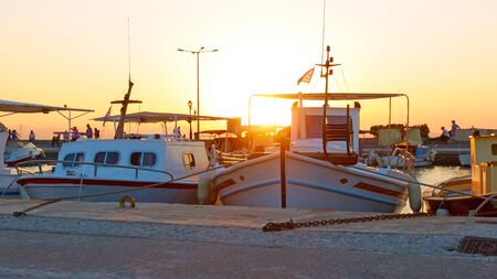 Port of Aegina with old fishing boats at sundown, Saronic Islands, Greece Reklamní fotografie