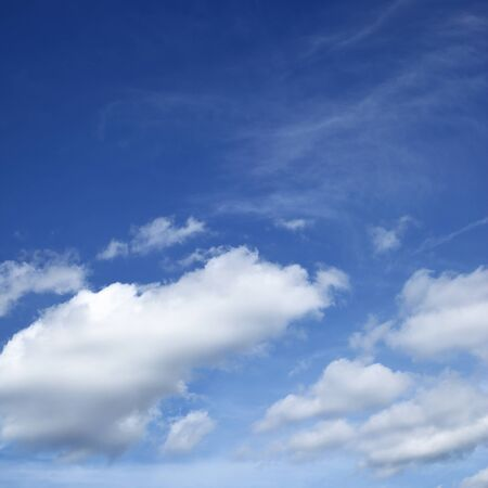 Deep blue sky with white heap clouds, may be used as background, square cropping 스톡 콘텐츠