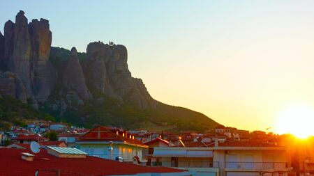 The Meteora rocks and roofs of Kalabaka town at sunrise, Thessaly, Greece - Landscape Reklamní fotografie