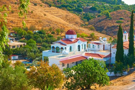 St Catherine Monastery surrounded by hills and gardens in Aegina Island, Greece - Greek lanscape
