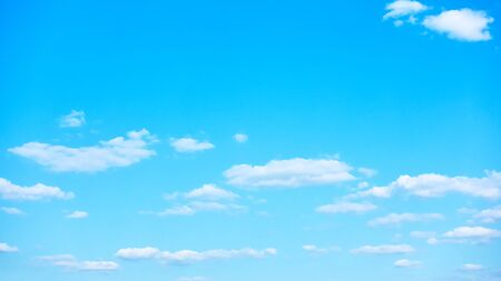Blue sky with white clouds -  background 16:9 with space for your own text