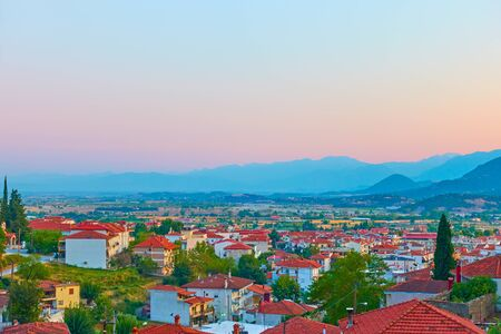 Panoramic view of Kalabaka town and Thessaly valley at sunset, Greece -  Picturesque greek scenery