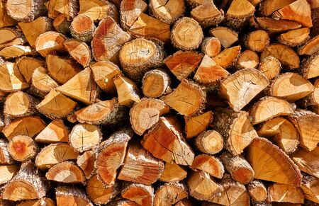 Firewood -  Stack of wood logs, wooden textured background