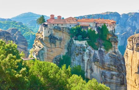 The Holy Monastery of Varlaam on the top of rock in Meteora in the morning, Kalabaka, Greece -  Greek landscape