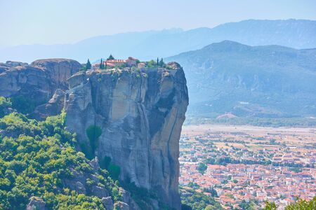 The Monastery of the Holy Trinity on the top of cliff in Meteora and Kalabaka town at the foot of rocks, Thessaly, Greece  - Greek landscape Reklamní fotografie