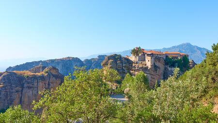 Panorama of Meteora with The Holy Monastery of Varlaam on the top of rock, Greece -  Greek panoramic landscape