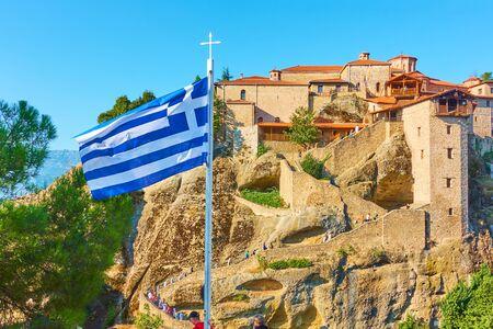Greek flag on flagpole near The Monastery of Great Meteoron in Meteora, Greece