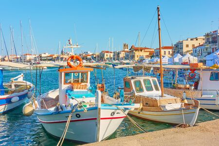 Old fishing boats in the port of Aegina, Saronic Islands, Greece