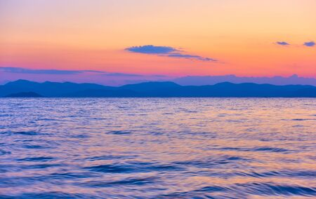 Beautiful sundown over Saronic Gulf of the Aegean Sea in Aegina Island, Greece - Sunset landscape